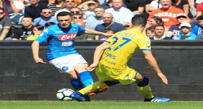 Napoli keep title race alive with dramatic win over Chievo
