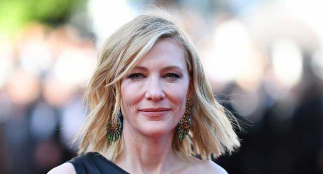 """Australian actress and President of the Jury Cate Blanchett poses as she arrives on May 12, 2018 for the screening of the film """"Girls of the Sun (Les Filles du Soleil)"""" at the 71st edition of the Cannes Film Festival in Cannes, southern France. LOIC VENANCE / AFP"""