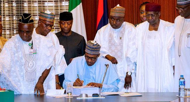Buhari Signs 2018 Budget, Faults NASS Over Inclusion Of 6,403 Projects