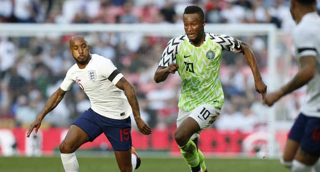 0c523c629c87a Nigeria s midfielder John Obi Mikel runs with the ball during the  International friendly football match between England and Nigeria at  Wembley stadium in ...
