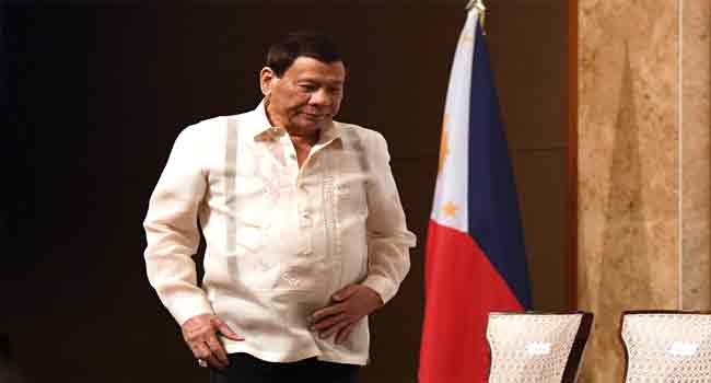 Anger Trails Philippines' President Kissing Woman On Stage