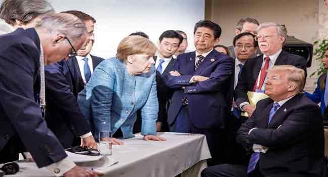 Merkel-Trump Face-Off Photo Makes History Books