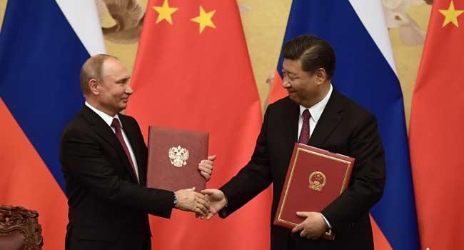 Xi, Putin Meet Amid U.S. Tensions