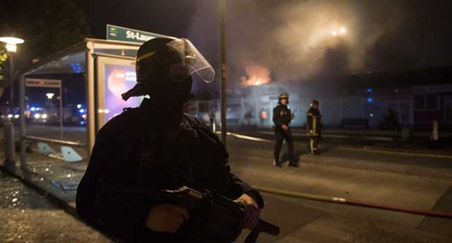 Twelve Arrested In Riots Over Police Killing Of French Youth