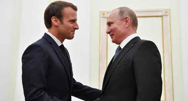 Macron Congratulates Putin For Hosting 'Perfect' World Cup