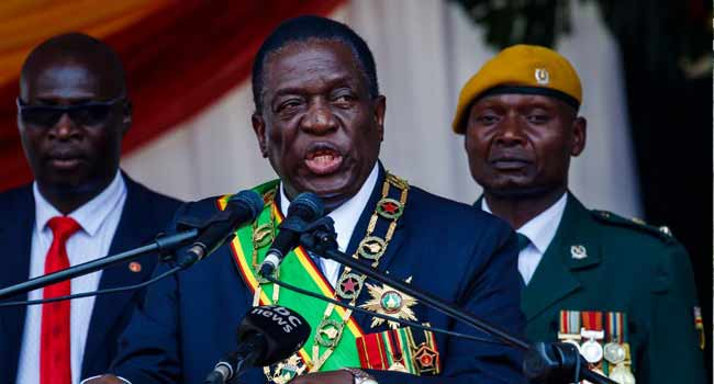Zimbabwe's President Emmerson Mnangagwa speaks during the Defence Forces Day celebrations held at the National Sports Stadium in Harare on August 14, 2018. Jekesai NJIKIZANA / AFP