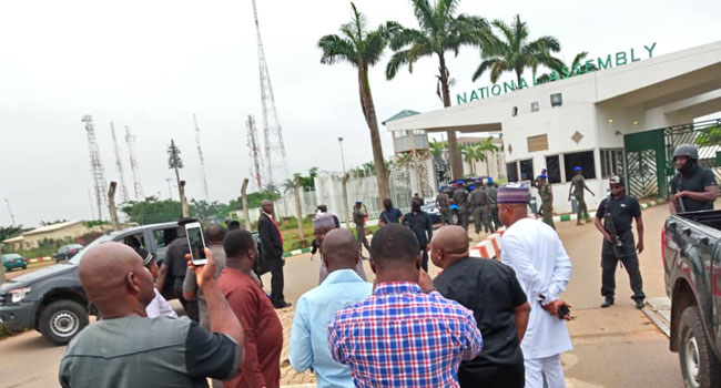 Security agencies barricade entrance of the National Assembly, preventing lawmakers, members of staff of National Assembly, journalists and other persons from entering on Tuesday, August 7, 2018.