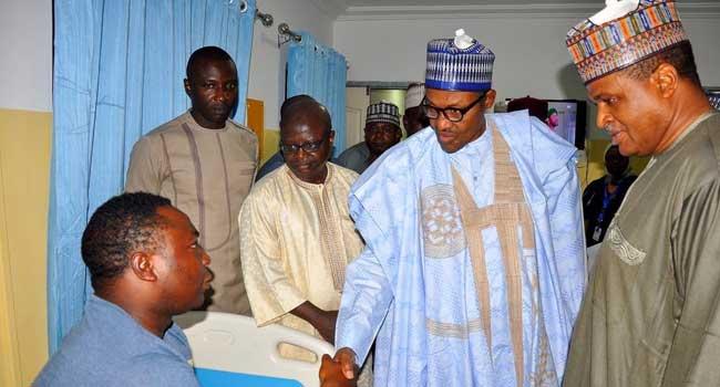 President Buhari Visits Injured Nigerian Air Force Pilots In Hospital