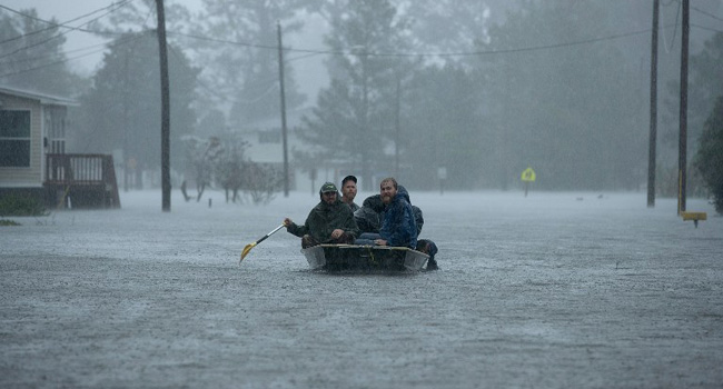 Killer storm far from over, US officials warn as 'epic' rain falls