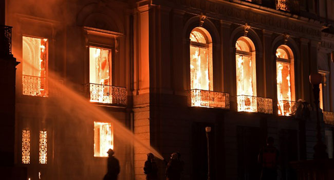 """A massive fire on Sunday ripped through Rio de Janeiro's treasured National Museum, one of Brazil's oldest, in what the nation's president said was a """"tragic"""" loss of knowledge and heritage."""