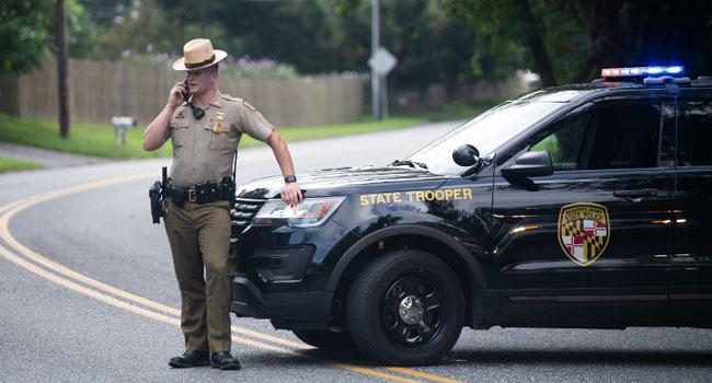 US Policeman Fatally Shoots Black Guard Who Detained Gunman
