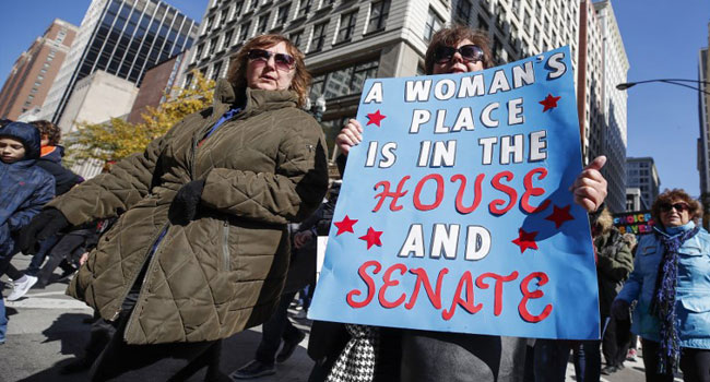 Thousands March In Chicago Against Trump's 'Anti-Woman Agenda'