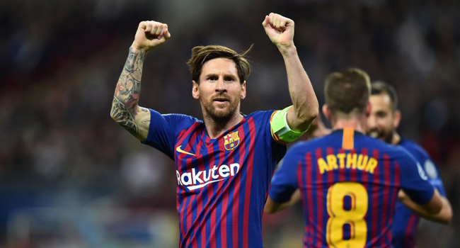 Barcelona s Argentinian striker Lionel Messi celebrates after scoring their  third goal during the Champions League group B football match between  Tottenham ... 8039ae4b0ff