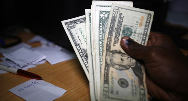 An Employee Shows Us Dollar Banknotes At A Foreign Currency Brokerage Office In Khartoum On October 7 2018 Ashraf Shazly Afp