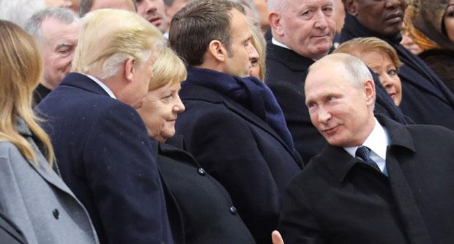 Trump, Putin Absent For Leaders' Symbolic Walk In Paris Rain