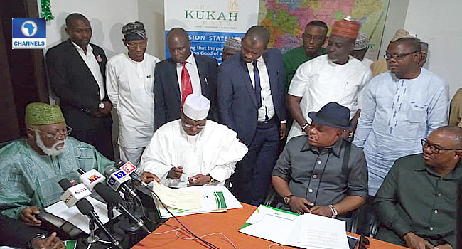 Image result for ATIKU SIGNS PEACE ACCORD