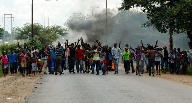 PHOTOS: Protest Rocks Zimbabwe As Government Increases Price Of Fuel