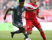 Bayern Munich's French defender Kingsley Coman (L) and Duesseldorf's German midfielder Marcel Sobottka (R) vie for the ball during the German first division Bundesliga football match in Duesseldorf, western Germany on April 14, 2019. Ronny Hartmann / AFP