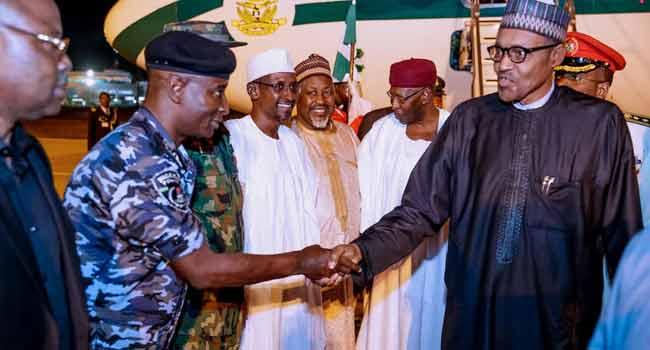 PHOTOS: Buhari Returns To Abuja After Jordan, Dubai Summit