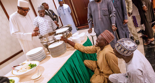PHOTOS: President Buhari Breaks Ramadan Fast With Artisans, IDPs, Others