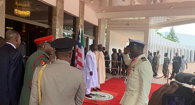 PHOTOS: George Weah Visits Buhari At Presidential Villa