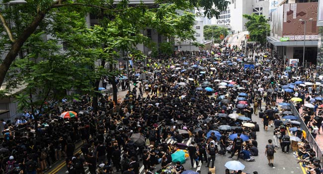 Thousands Converge On Hong Kong Police HQ In Anti-Govt Protest