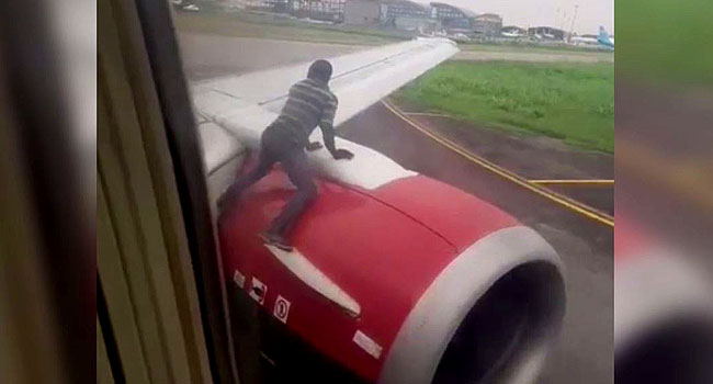 Drama as man climbs roof-top of Azman aircraft at Lagos airport