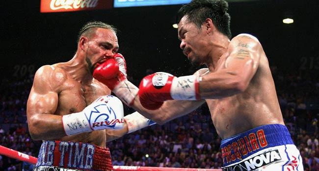 Manny Pacquiao Defeats Thurman To Capture WBA Crown