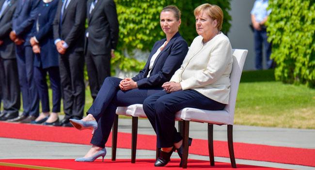 Merkel Sits Through Anthems After Shaking Spells