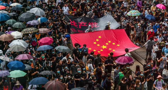 Hong Kong Stocks Take A Hit As Protest Continues