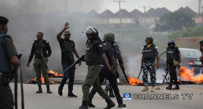 Protesters Burn Tyres As Police Prevent Attack On Shoprite In Abuja