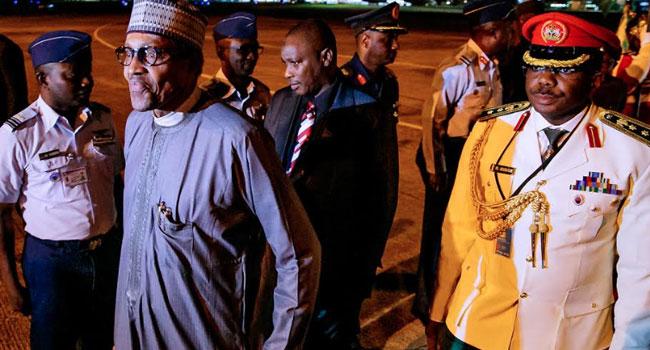 PHOTOS: Buhari Returns To Abuja