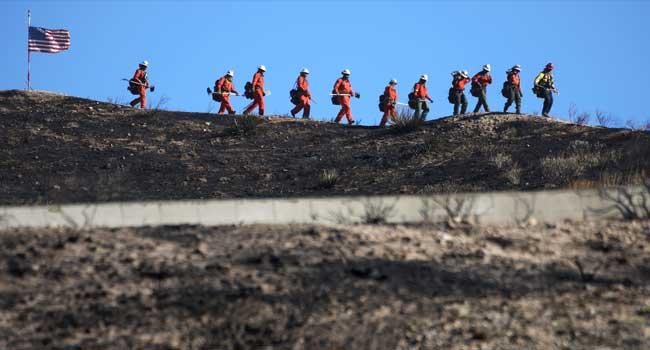 California Evacuates 50,000 As Fires Spread