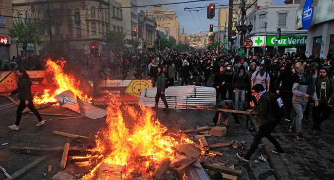 Chile Protest: Child Killed As Toll Rises To 18