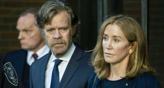 Felicity Huffman reports to prison to start two-week sentence