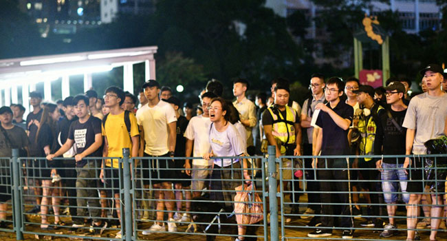 Multiple Arrests In Hong Kong As 'Flashmob' Protests Hit Pro-Bejing Targets
