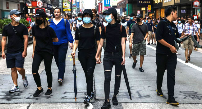 Police Make Arrests As Flashmob Protests Erupt In Hong Kong
