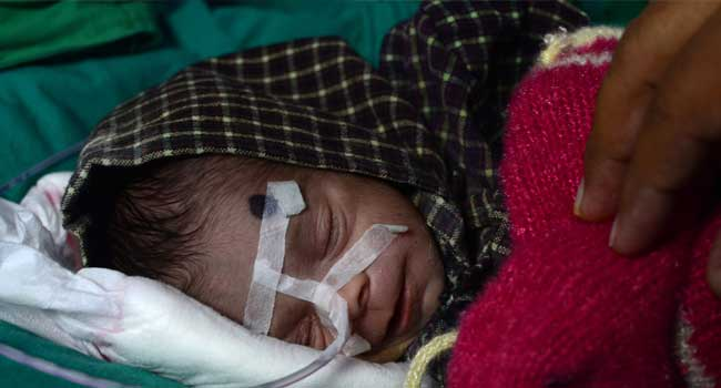 'Miracle' Baby Survives After Being Buried For Days