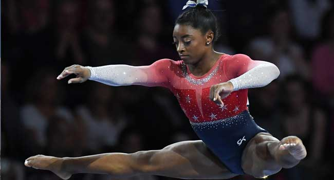 Simone Biles wins 15th world title as US claim team gold