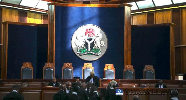 PHOTOS: Seven-Man Panel Headed By CJN Hears Atiku's Appeal Against Buhari