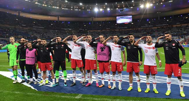 Turkish footballers repeat military salutes in France match