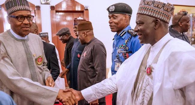 PHOTOS: Buhari Returns To Abuja After Russia-Africa Economic Summit