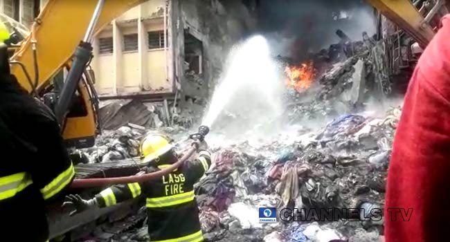 PHOTOS: Firefighters Battle Lagos Market Fire One Day After