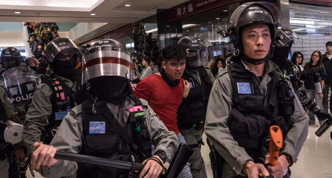Dozens arrested and pepper-sprayed after protesters storm Hong Kong shopping centre