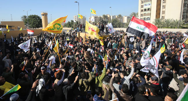 Iraq PM Asks Protesters To Leave US Embassy 'Immediately'