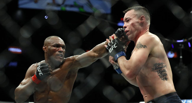 Nigeria's Usman Knocks Out Covington To Retain UFC Title