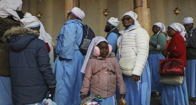 Pilgrims Gather In Bethlehem For Christmas Celebration