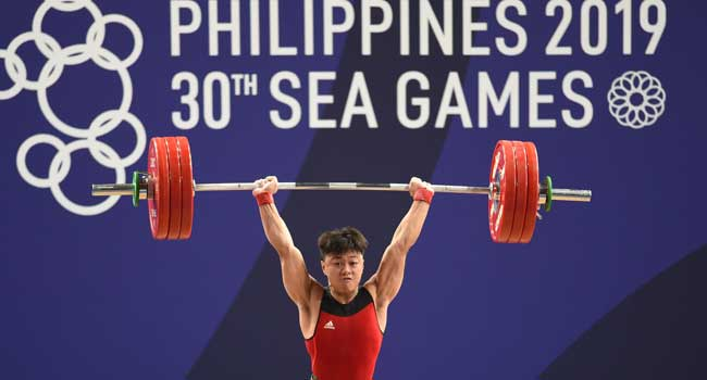 Tearful Weightlifter Claims Gold As SEA Games Bounce Back From Typhoon