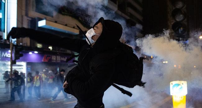 Police, Protesters Clash As Hong Kong Celebrates Christmas