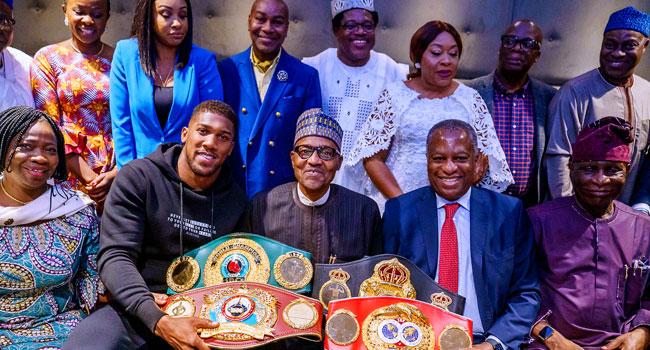 Anthony Joshua Presents his Heavyweight belts To Buhari In UK